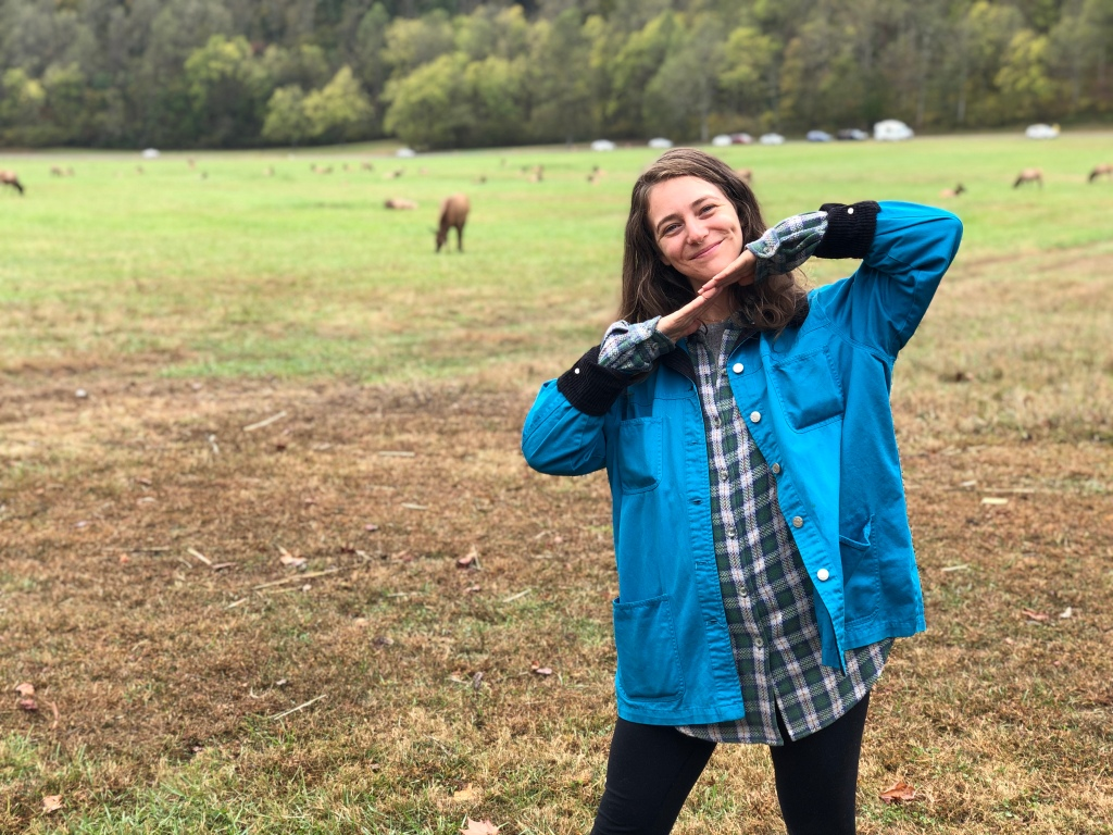 Image of Sam Hall posing in front of Elk in Maggie Valley, NC